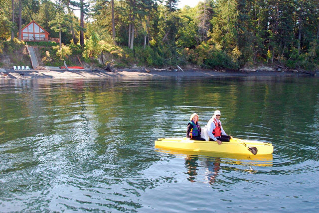 Two passengers going ashore in tandem kayak - tender
