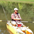 Ray-Texan kayak fisherman fishing in Mountain Fork river, SE Oklahoma