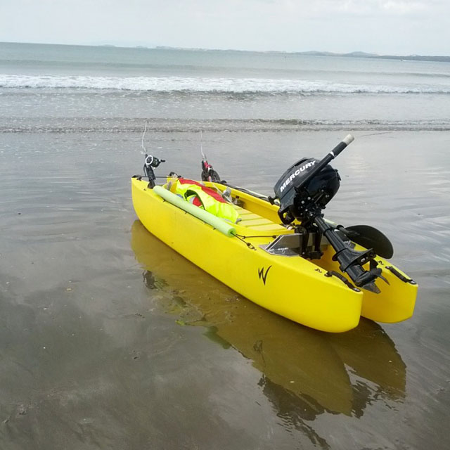 fishing kayak outfitted with a mercury outboard motor