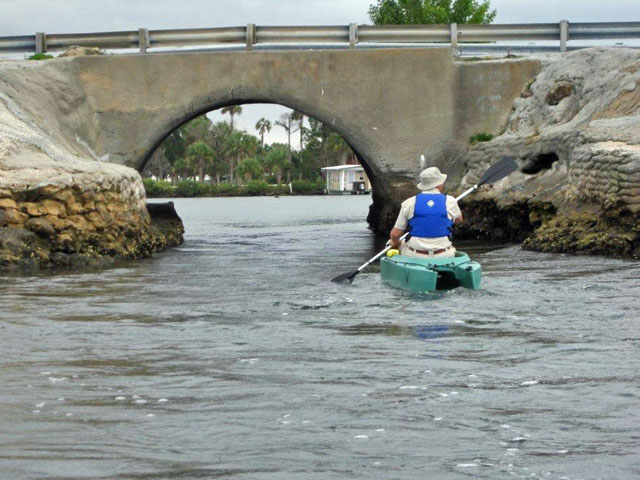 art-paddling-his-kayak-towards-the-culvert (2)