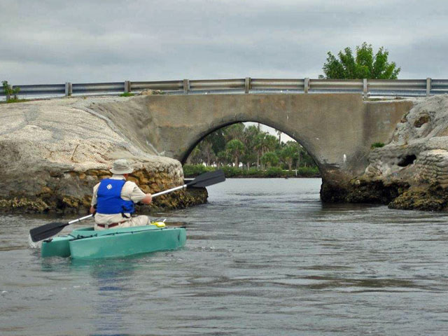 art-paddling-his-kayak-towards-the-culvert