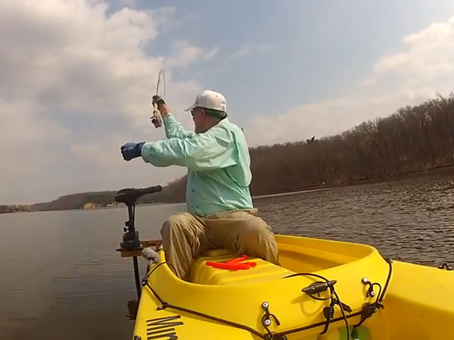 fly-rod-pointing-behind-angler-fly-fishing-kayak