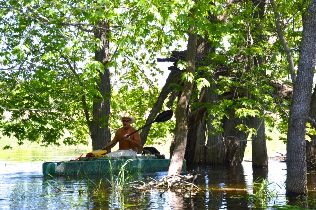 john-kayaking-among-the-trees-in-the-flooded-forest