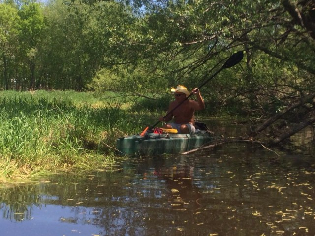paddling-a-kayak-over-an-obstacle-in-shallow-water-rock-river-wi