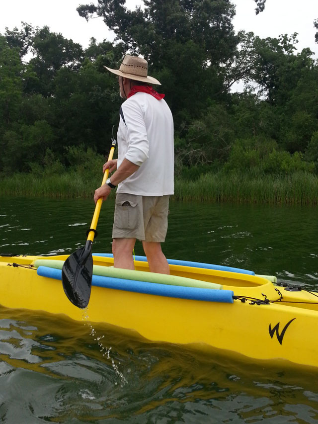 Aaron-paddling-standing-in-his-fishing-kayak