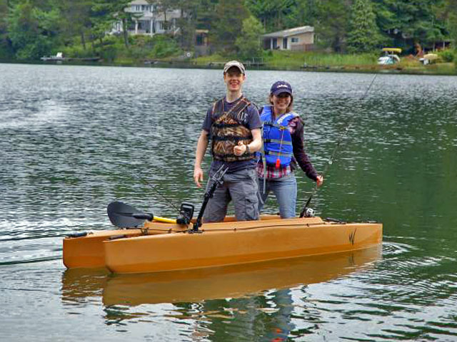 boy-and-girl-fishing-standing-in-their-tandem-kayak-WA