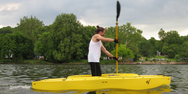 tony-paddling-standing-in-his-fishing-kayak