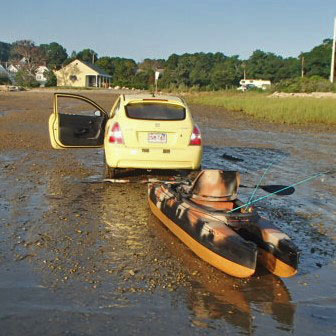 launching my rigged camo kayak out of my car