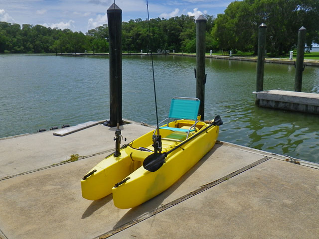 w-fishing-kayak-outfitted-with-sand-chair-on-top-of-the-seat