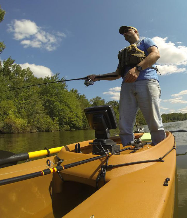 big-and-heavy-fisherman-fishing-standing-in-kayak