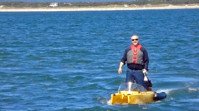 driving-motor-kayak-standing-offshore-640