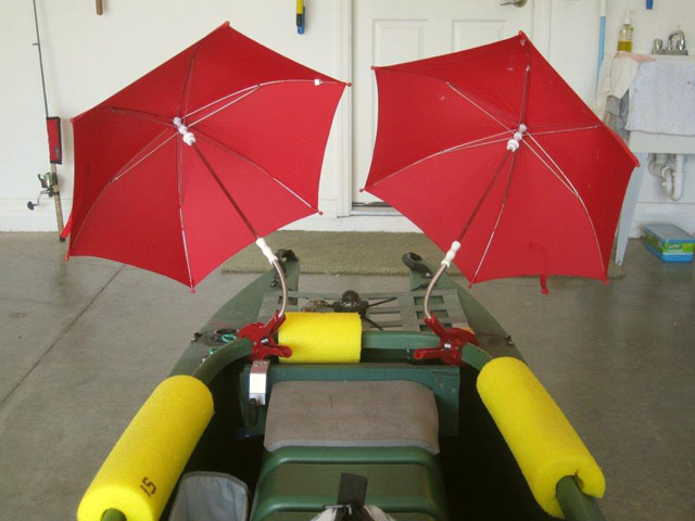 fishing-kayak-outfitted-with-two-sailing-umbrellas