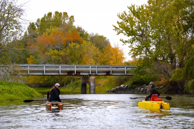 paddling on the river with autumn colors