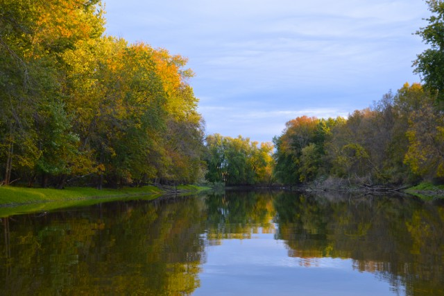scenic view of the river with autumn colors