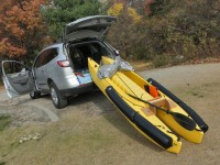 The boat fits inside the SUV with the flotation and spray shield on, and the motor dismounted.
