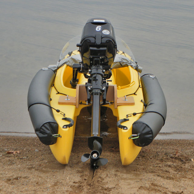 beached motorized fishing kayak
