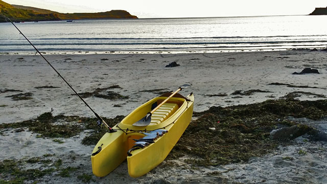 kayak-beached-with-fish-and-ocean-view-hebrides-scotland