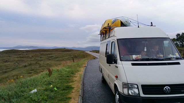 van-with-fishing-kayak-attached-to-rack-hebrides-uk