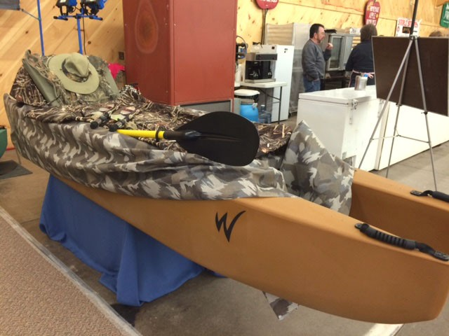 hunting-kayak-with-camo-cover-sand-colored