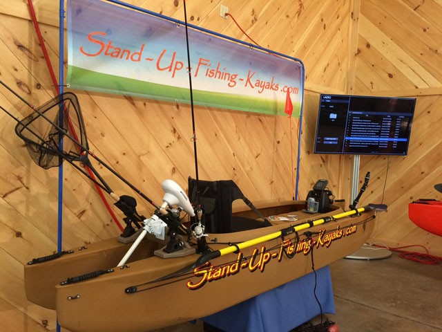 sand-colored-kayak-with-electric-trolling-motor-and-fishing-electronics-fish-nets