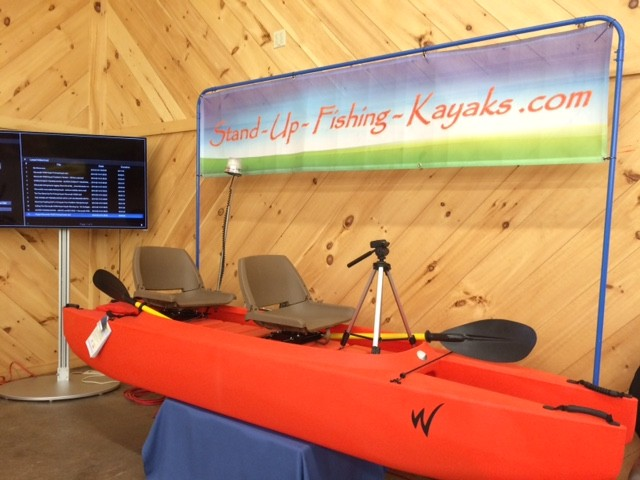 twin-hull-kayak-with-two-swivel-seats-and-camera-tripod