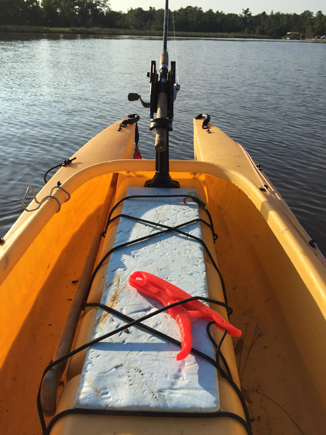 fishing-kayak-saddle-outfitted-for-storage