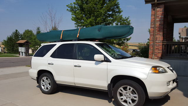 W700-tandem-fishing-kayak-car-topped-on-SUV