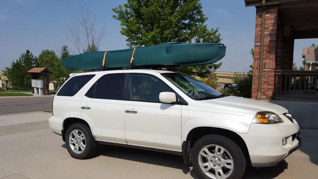 W700-tandem-fishing-kayak-car-topped-on-SUV