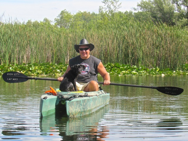 john-paddlig-his-fishing-kayak-and-wilson-basking
