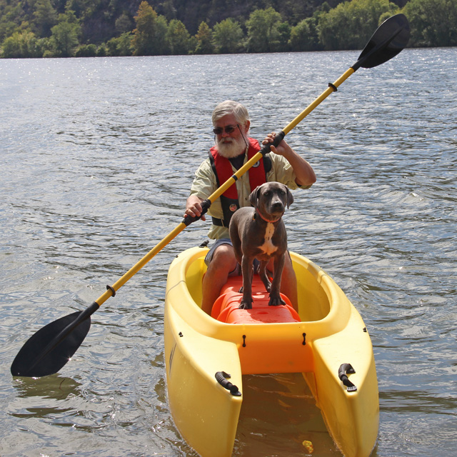 angler-and-dog-on-board-kayak