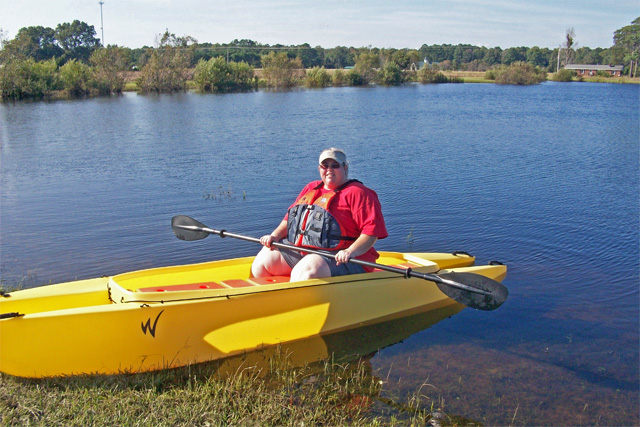 Jill-sitting-in-her-fly-fishing-kayak