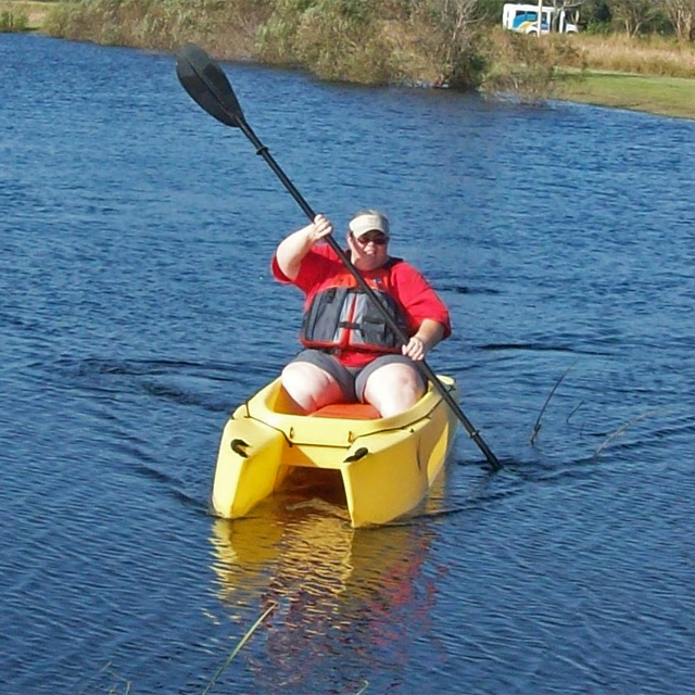 heavy-angler-paddling-her-W700-fishing-kayak