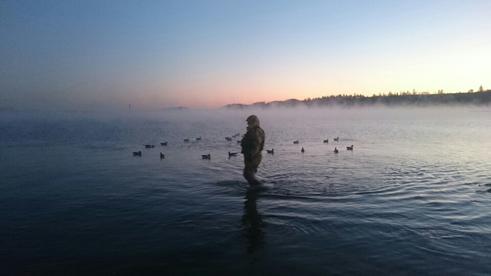 duck-hunter-standing-in-the-water