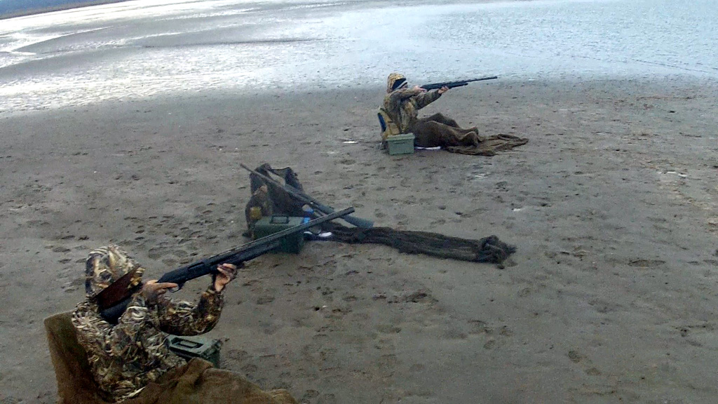 duck-hunters-shooting-from-the-beach