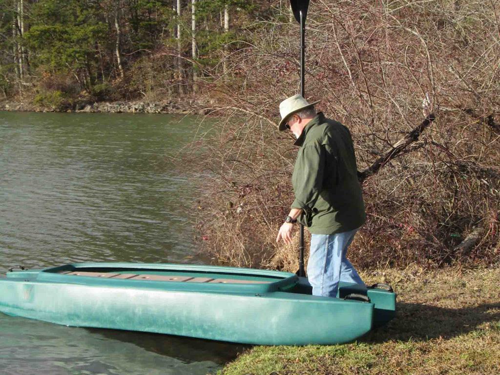 1-kayak-launching-stepping-into-the-kayak