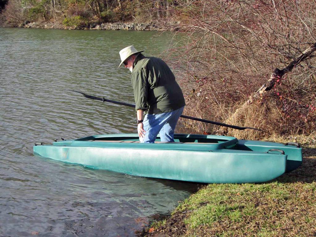 2-kayak-launching-entering-the-cockpit
