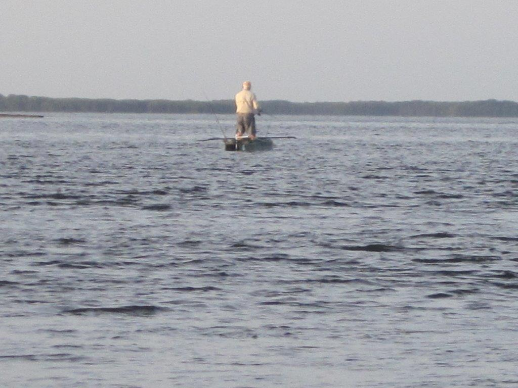 Bob fly fishing standing in his electric kayak