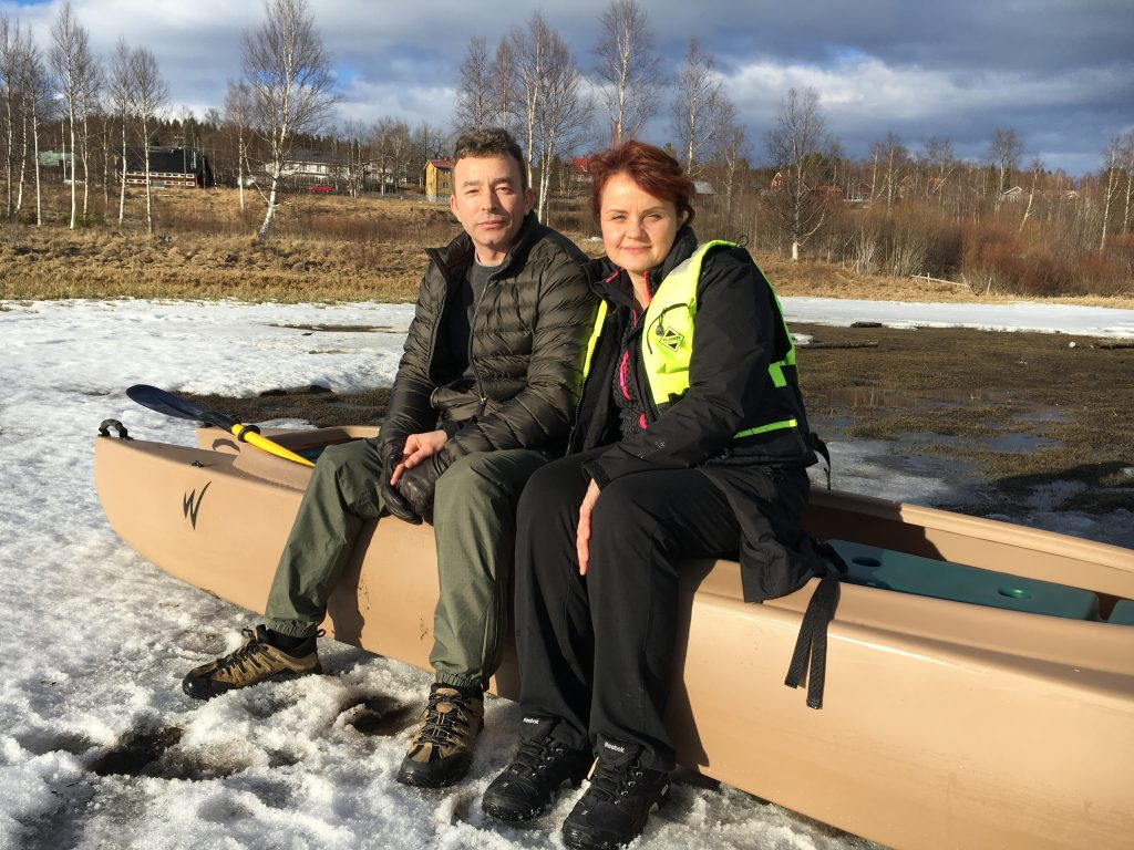 Valeri-and-Milena-sitting-on-the-kayak-on-the-ice