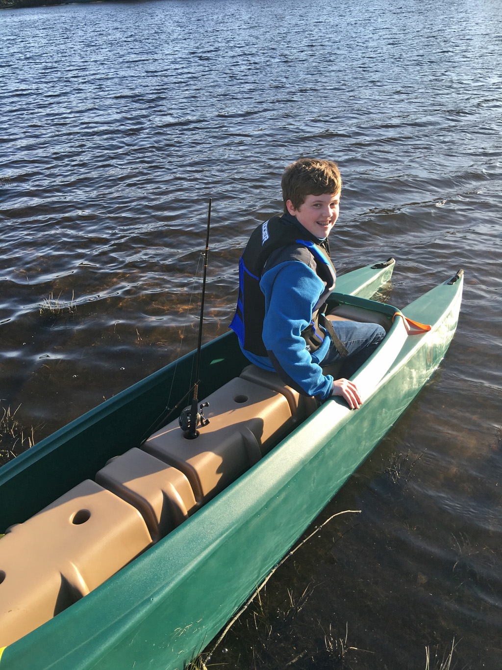 boy-sitting-in-the-front-of-a-W700-tandem-fishing-kayak