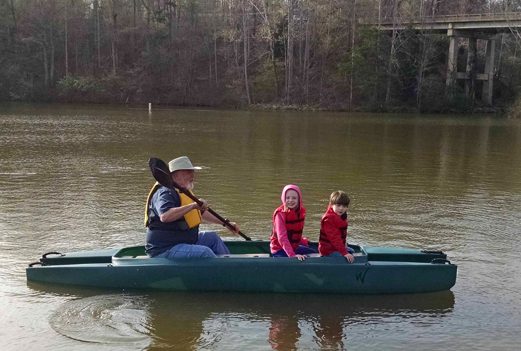grandpa-paddling-fishing-kayak-with-two-grandchildren-on-board-56