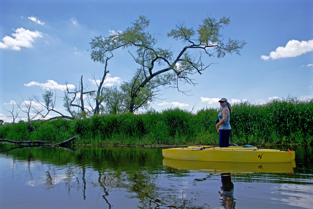 jeanne-paddling-standing-in-her-fishing-kayak
