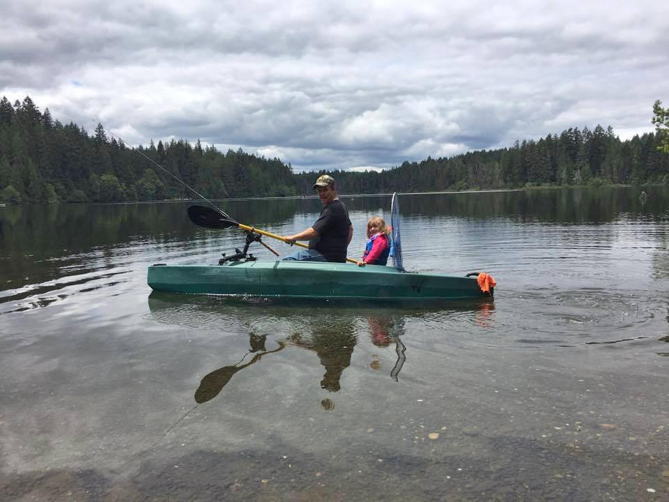 Chris guiding a kid angler on board W500 kayak