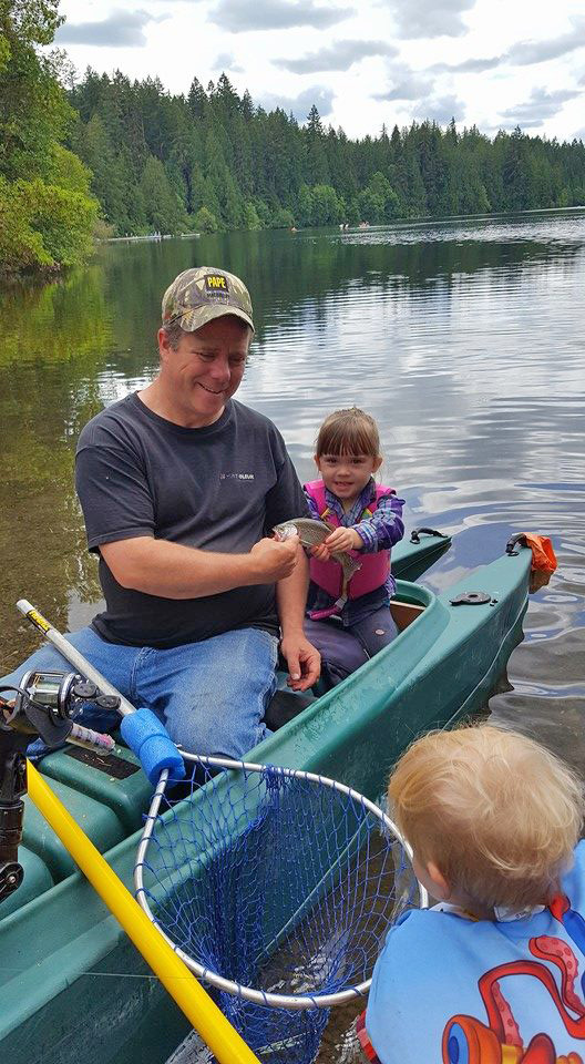 Chris talking fishing with two young anglers