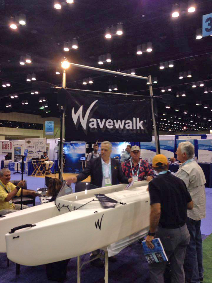 Larry and Yoav standing next to the Wavewalk 700 Microskiff