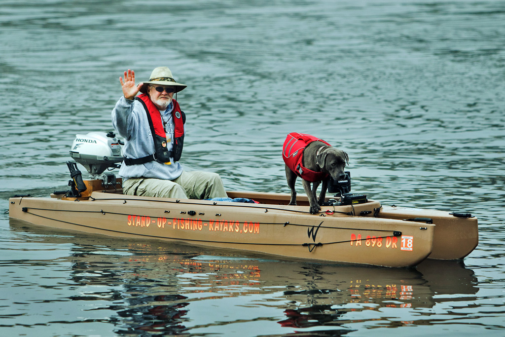 joe-and-dog-on-board-portable-fishing-boat-01-1024