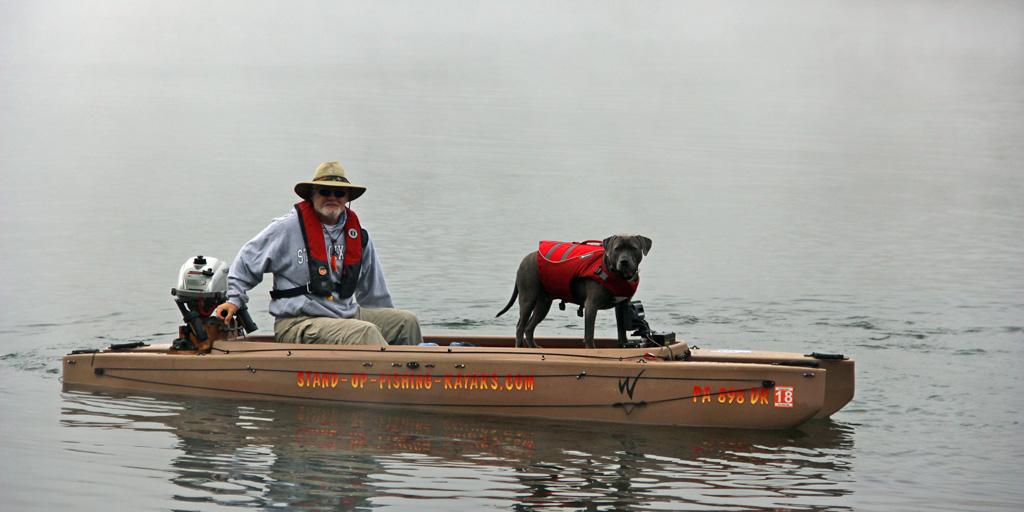 fisherman-driving-electric-fishing-kayak-with-dog-on-board-04-1024