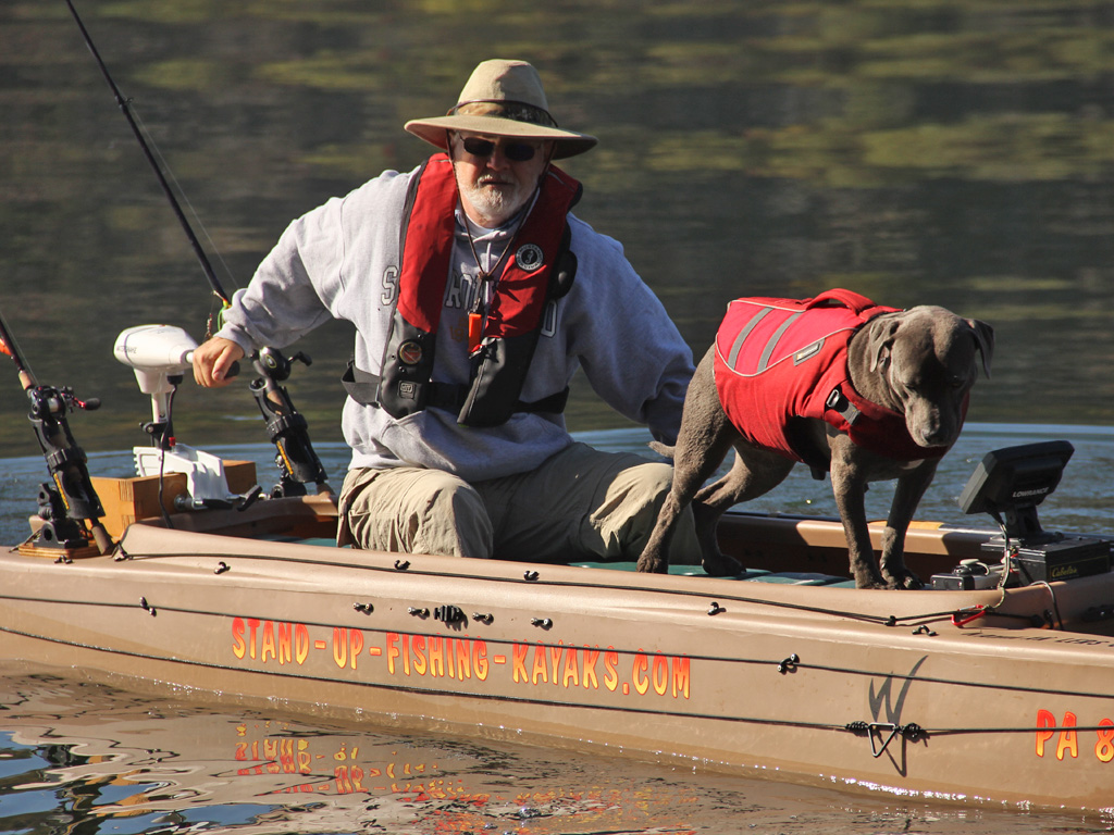 fisherman-driving-electric-fishing-kayak-with-dog-on-board-07-1024