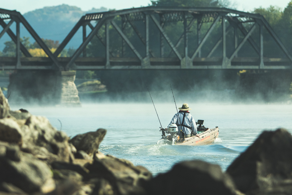 fisherman-driving-motorboat-on-susquehanna-river-01