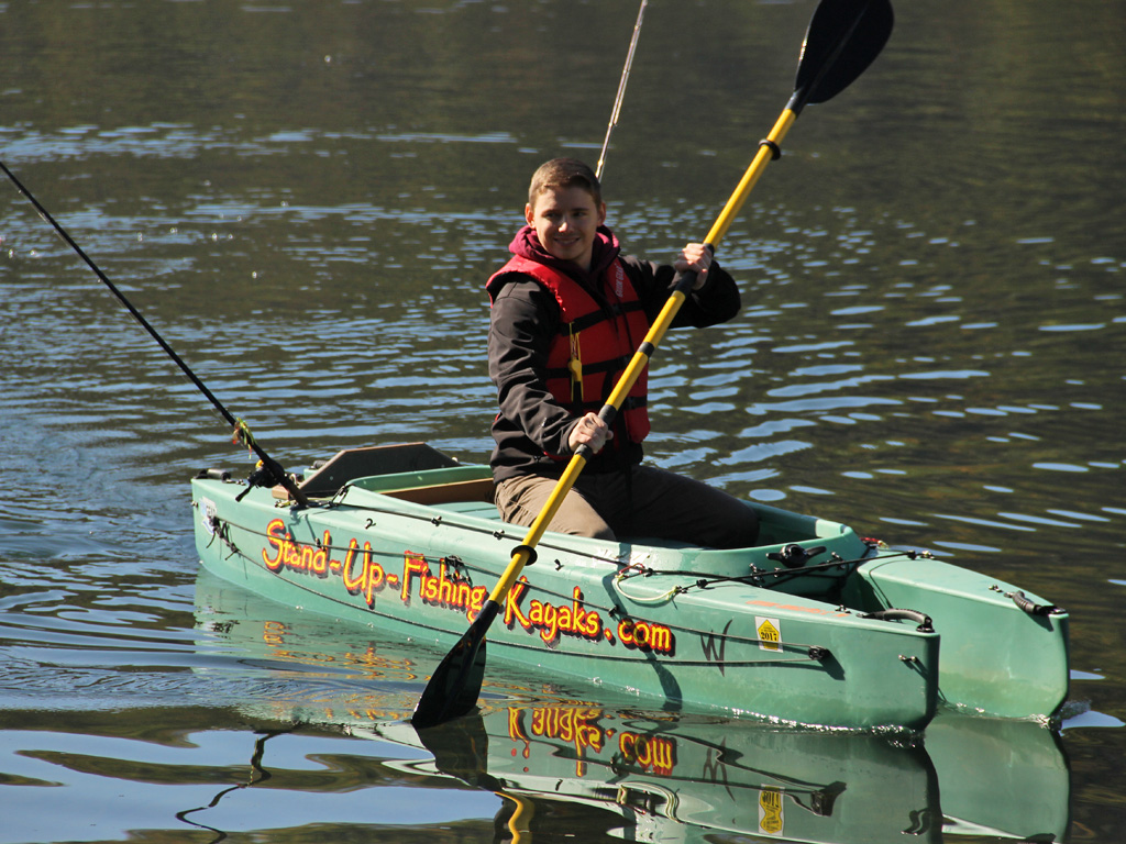 young-kayak-fisherman-paddling-01