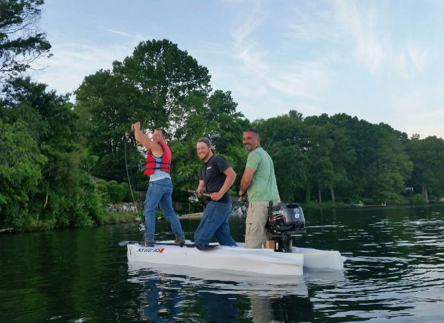 Three anglers fishing standing in the world's most stable kayak, the Wavewalk S4